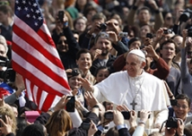 The U.S. flag is seen as Pope Francis greets the crowd during his arrival to lead his general audience in St. Peter's Square at the Vatican March 27. (CNS photo/Paul Haring) (March 27, 2013) See POPE-AUDIENCE March 27, 2013.pope-US-flag.jpg